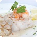 Filets de sole Dieppoise (Sole fillet served with a white wine sauce)