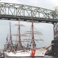 Picture of USCG Barque Eagle entering historic Wilmington, NC under the Cape Fear Memorial Bridge