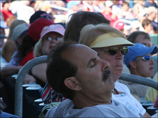 sleeping baseball fan