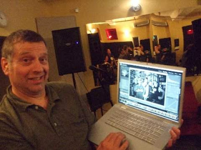 Tony with MAC book (his pride and joy!)  Please note band rehearsing in the mirror