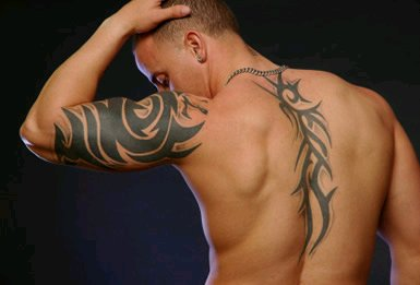 Mask Tribal tattoo on men body
