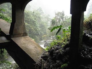 Hanging out under the bridge at the Wakani Falls during a rain storm