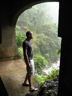 Hanging out under the bridge at Wakani Falls during a rain storm.