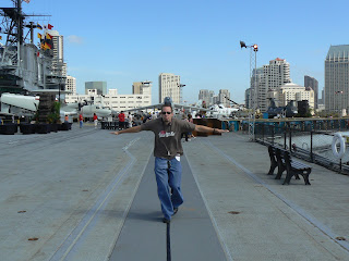 Running down the catapult line of the USS Midway Aircraft Carrier
