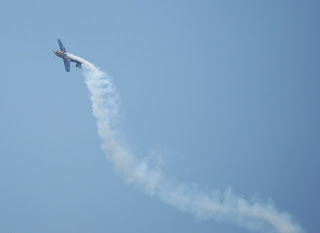 Race Plane going into barrel rolls after completing the course.