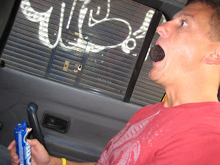 Chad eating an Oreo in a Buenos Aires taxi.