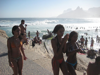 Girls at Ipanema Beach with the Two Brothers visible in the distance.