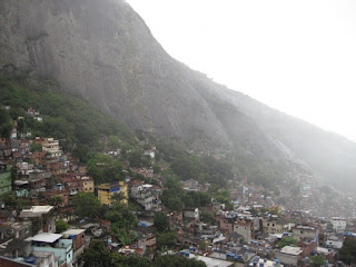 The favela climbs up the hill under the granite face of one of the Two Brothers.