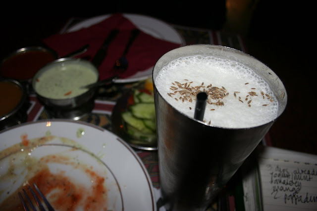 salty lassi topped with caraway seeds