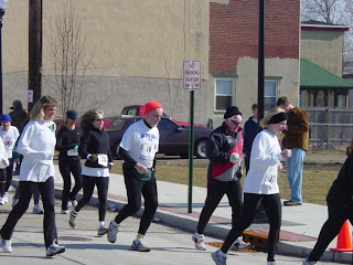 Harry Berkowitz, center in red cap, runs a race in Gloucester, NJ