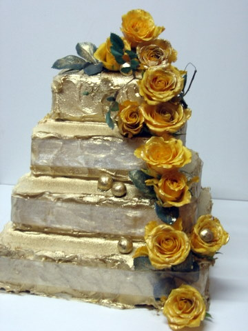 4 Tier Gold Wedding Cake R1600 This is a Chocolate Cake Covered in Gold