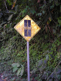 Stream over road sign, Honduras