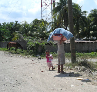 boy carrying laundry, Honduras