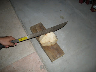 Cutting coconut with machete