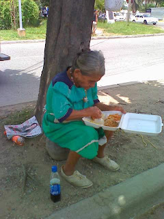 Honduran woman eating lunch, La Ceiba, Honduras