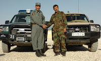 Bakhtyar Padschagul, left, Nijrab District police cheif, and Commander Mohammad Ashraf, commander, Afghan National Army 3rd Brigade, 201st Corps, shake hands at Forward Operating Base Morales-Frazier in the Nijrab District, Kapisa province, Afghanistan, June 20. Padschagul and Ashraf are known throughout Nijrab for working together to bring stability and security to the people of the district. (U.S. Army photo by Sgt. Jessica R. Dahlberg)