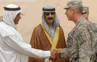 Col. Kenneth Newlin meets with local leader Sheik Shehab Ahmed Saleh Al-Tamimi on June 17 during the commemoration of a service center aimed at improving Iraqi-based industry. (Army photo by Sgt. Robert G. Cooper III)