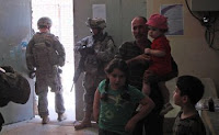 Soldiers provide security during a visit to a medical clinic in the Muthana-Zayuna area of eastern Baghdad.