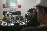 Sheikh Hamid Ahmed Al-Hashim, city council chairman, and Sa'ad Awad Rashad Al-Dulaimi, city mayor, conduct a question and answer session with local Arab media after the State of the City Address for the Fallujah, Aug. 8, 2008. Hamid delivered his speech to Fallujah citizens addressing the progress the city has made this year, focusing on the quality of life projects and security improvements.