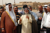 Neighborhood leaders address the crowd during a resettlement ceremony in September. Improved security throughout Baghdad has spurred a return of former residents and a rise in reconstruction efforts there.