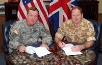 Brig. Gen. Kenneth Dowd, CENTCOM Director of Logistics, and Brigadier M.G. Hickson, Late Royal Logistics Corps, sign the first full Implementing Agreement between the United States and United Kingdom for logistics support in Afghanistan Wednesday.