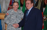 Army Gen. David H. Petraeus, commander of U.S. Central Command, shakes hands with Afghan Defense Minister Abdul Rahim Wardak before a meeting with Afghan officials at Defense Ministry headquarters in Kabul, Afghanistan, Nov. 5.