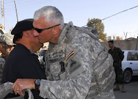 Maj. Gen. Mark Hertling, commander of the 1st Armored Division and Multi-National Division-North, greets Maj. Gen. Jamal Thakr Bakr outside of the Kirkuk police headquarters during a visit to Kirkuk City, Iraq, Dec. 4. Maj. Gen. Robert Caslen Jr., commander of the 25th Infantry Division (light), will assume command from Hertlings Multi-National Division-North, Dec. 9, in Tikrit, Iraq.