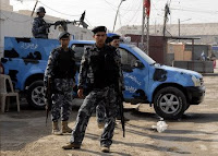 Iraqi police guard polling stations during the time between the special elections conducted on Jan. 28 until the general elections scheduled for Jan. 31. Iraqi security forces are in the lead for providing security at polling stations for voters during the Iraqi provincial elections.