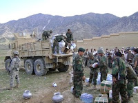 Afghan troops unload relief supplies hours after an earthquake hit the Sherzad district of Nangarhar province, Afghanistan April 17.