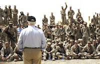 U.S. Defense Secretary Robert M. Gates talks to Marines deployed to Field Operating Base Bastion, Afghanistan, during his to southwest Asia.