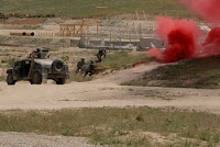 Afghan National Army commandos of the 6th Kandak react to a simulated bomb blast and follow-on firefight during a demonstration of combat techniques and procedures held in conjunction with the first ANA Corps and Commando Commanders' Conference...