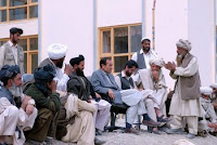 An elder with the Kuchi tribe explains his situation to Ali Khashe, deputy governor of Afghanistan's Wardak province. The Kuchi have asked for water and veterinarian supplies for their livestock as a condition to stop fighting with the Hazara tribe.