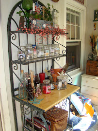 The baker's rack holds lots of treasures and is right next to our front door.