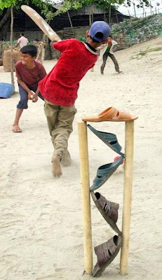 kids-playing-cricket-beach-slippers-stumps