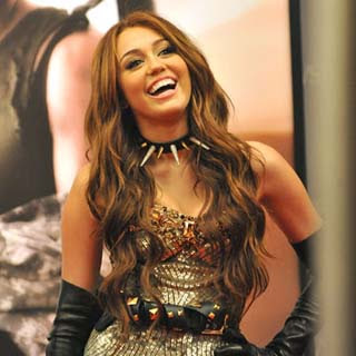 You laugh you lose - Page 2 Miley+Cyrus+%E2%80%93+Can%E2%80%99t+Be+Tamed
