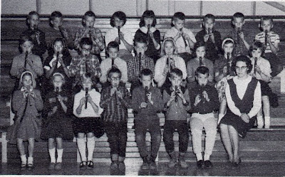 The fourth grade of St John Elementary School in Seward, Nebraska, playing recorders. The image was scanned from the 1965-1966 yearbook.