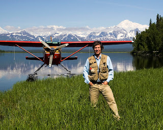 Mark Stadsklev as an adult, standing in front of an airplane in Alaska. The image was taken from his website, www.alaskaphotopilot.com