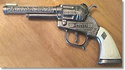 A cap-gun pistol (closed). Image taken from http://www.nicholscapguns.com/halco.htm