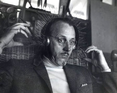 Reinhold Marxhausen Wearing a Sound-Making Ear Sculpture. The image was taken from http://marxhausen.squarespace.com/blog/?currentPage=2