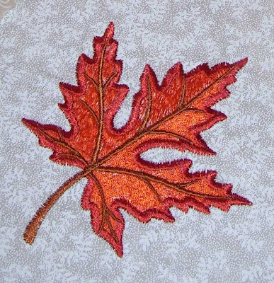 The colorful maple leaf embroidery is an Anita Goodesign embroidery design.