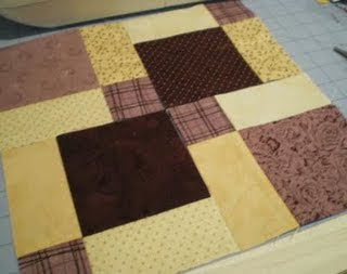 Check out the MissyMack blog - Sam sewed this great Disappearing Nine Patch quilt block. It's my inspiration for a new quilt.