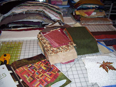 A large pile of fabric scraps to cut to size for strips in the background.