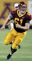 Gopher football player running for the ball