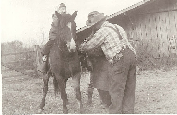 Uncle Guy & Daddy are tightening Betty's saddle.