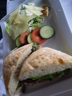 Skirt Steak Sandwich with caesar salad and fresh vegetables, The Cannery Restaurant, Port of Vancouver, BC