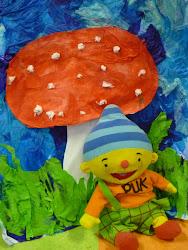 Puk met een paddenstoel.