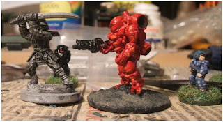 L to R: 25mm Samurai by Eureka Miniatures, Cyclops battle suit by Ground Zero Games