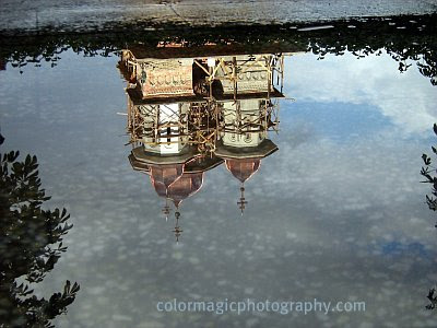 Church reflection on the water after rain