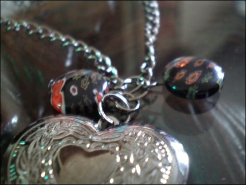 A picture (sorry, it's a little blur) of the heart locket and lampwork glass