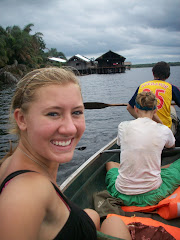 Us on the canoe with Nzulezo behind